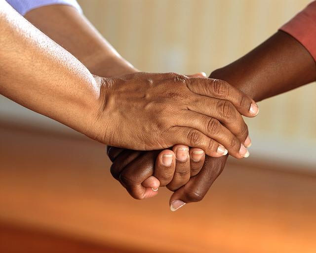 Caregiver holding hands